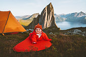 Baby on camping mat in mountains family vacations adventure healthy lifestyle cute child hiking activity kid outdoor in Norway Segla mountain landscape