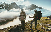 Couple travelers on mountain summit together love and Travel Lifestyle wanderlust concept adventure vacations outdoor