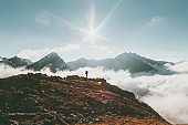 Mountains landscape Travel lifestyle adventure concept traveler standing alone summer vacations outdoor sunny day