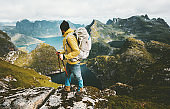 Man hiker exploring mountains of Norway Traveling healthy lifestyle adventure concept hiking with backpack active summer vacations outdoor