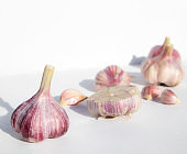 Whole garlic and cloves on a white background with space for text. Spicy food concept. Poster, menu.