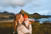 Mother and baby family traveling in mountains hiking healthy lifestyle mom and child together active vacations trip outdoor in Norway