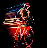 woman triathlon triathlete cyclist cycling isolated black background