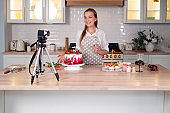 Blogger pastry chef makes a video lesson about cooking a cake.