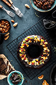 Christmas chocolate bundt cake decorated with oranges, berries and rosemary