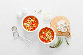 Tuscan tomato chickpea soup with various vegetables, thyme and parmesan cheese, top view
