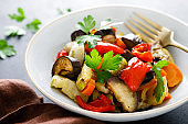 Baked vegetables salad with fresh parsley