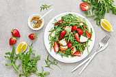 Strawberry salad with arugula and chicken meat