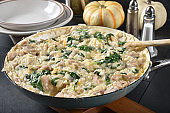Chicken spinach rice casserole in a cast iron skillet