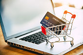 Small shopping cart with credit card on laptop, online shopping and shopping concept