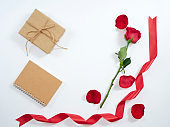 Red rose with red ribbon, diary, gift box. Love symbol. For card and wedding.