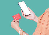 Women using smartphones to pay with credit card for online shopping