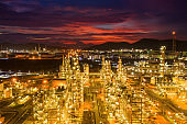 Aerial view Oil refinery.Industrial view at oil refinery plant form industry zone with sunrise and cloudy sky.Oil refinery and Petrochemical plant at dusk Thailand. Oil refinery background.