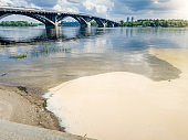 Image of river being polluted by toxic wastes from factories