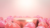 Golden round stage, podium or pedestal in pink studio filled with pink party air balloons. Perfect background or mockup for celebrations, party, greetings and invitations. 3d render. Place your object or product on podium.