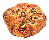 Ruddy bun stuffed with olives, tomatoes, cheese and basil
