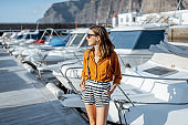 Woman in the marine with yachts and boats