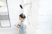 Woman in the room with video surveillance