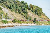 Freight train moves along Black sea. Sochi.