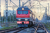 Passenger train departs at sunset time. Moscow.