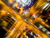 abstract blurred aerial view to crossroads with car lights and zoom effect