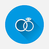 Vector icon wedding rings. Two rings male and female with a diamond. Symbol of love and family well-being on blue background. Flat image with long shadow.