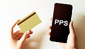 gold card and phone with text disaster recover plan PPS in the female hands
