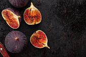 Fresh ripe figs in on a dark background.