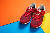 New fashionable red men's sneakers on a bright background.