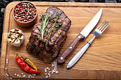 Juicy steak with vegetables on a wooden board.