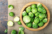 Brussels sprouts in a wooden bowl. Harvesting.
