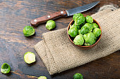Brussels sprouts on rustic wooden table.