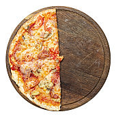 Pizza floor on a wooden plate. Italian traditions.