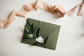 Green modern recycled paper wedding invitation on white background