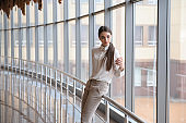 Young woman at international airport. Female passenger at terminal, indoors.