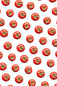 Fresh natural organic tomatoes pattern against a white background.