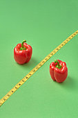 Symbol of percent from red organic paprika pepper and measure tape.