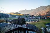 Traditional rural landscape with houses, fields and mountains in Austria.