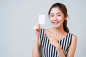 smart casual asian beautiful female smile hand show blank template card  with cheerful white background