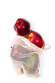 Fresh red apples spreading out from eco bag