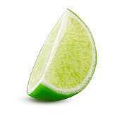 Lime slice. Green lemon lime cut closeup detailed on white background isolated