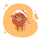 Cute cartoon ox with holiday candy.Happy new year