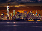 New York City Skyline with World Trade Center and Manhattan Financial District at Sunset.