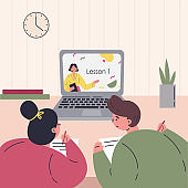 Online education.Kids learn lessons on laptop