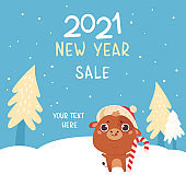 Cute cartoon ox on a winter landscape