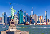 Statue of Liberty and New York City Skyline with World Trade Center, Beekman Tower and Woolworth Building, NY, USA.