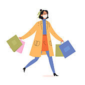 Young fashionable woman holding packages