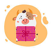 Cute cartoon ox with a gift box.Happy new year
