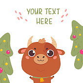 Cute cartoon ox with the Christmas tree