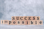 Wood cube letter word of possible and success. Idea of motivation and inspiration in business vision and corporate management strategy. Leadership lead teamwork to reach achievement.